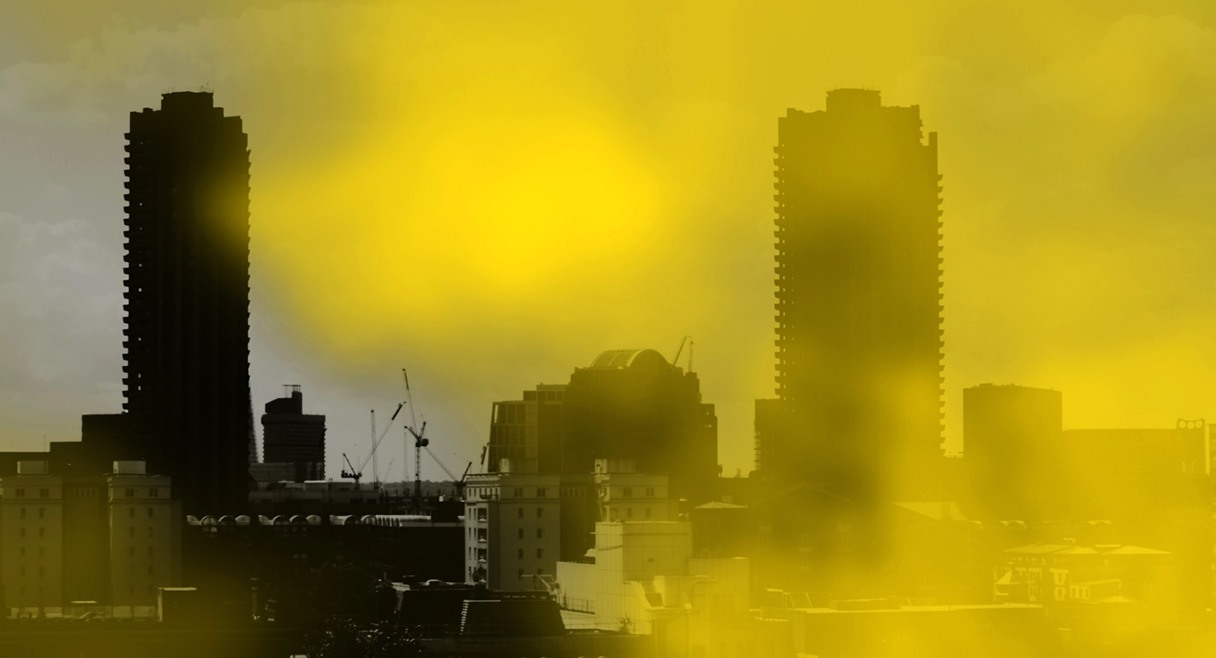 image of a city scape with yellow toxic dust surrounding it