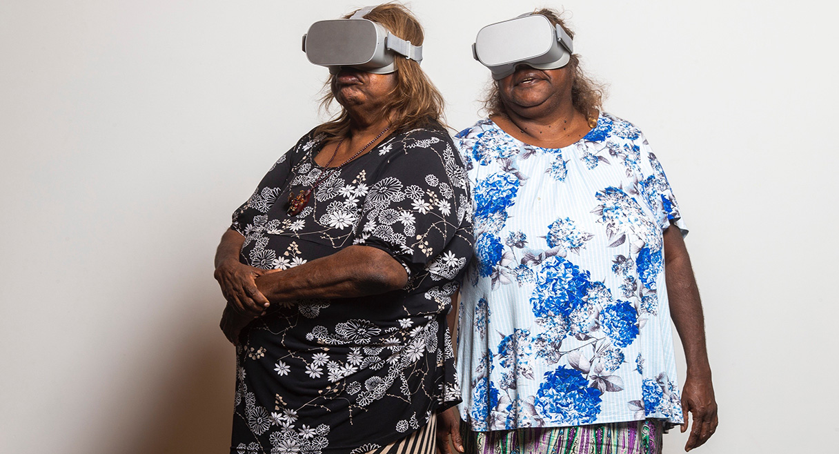 two indigenous women wearing VR headsets