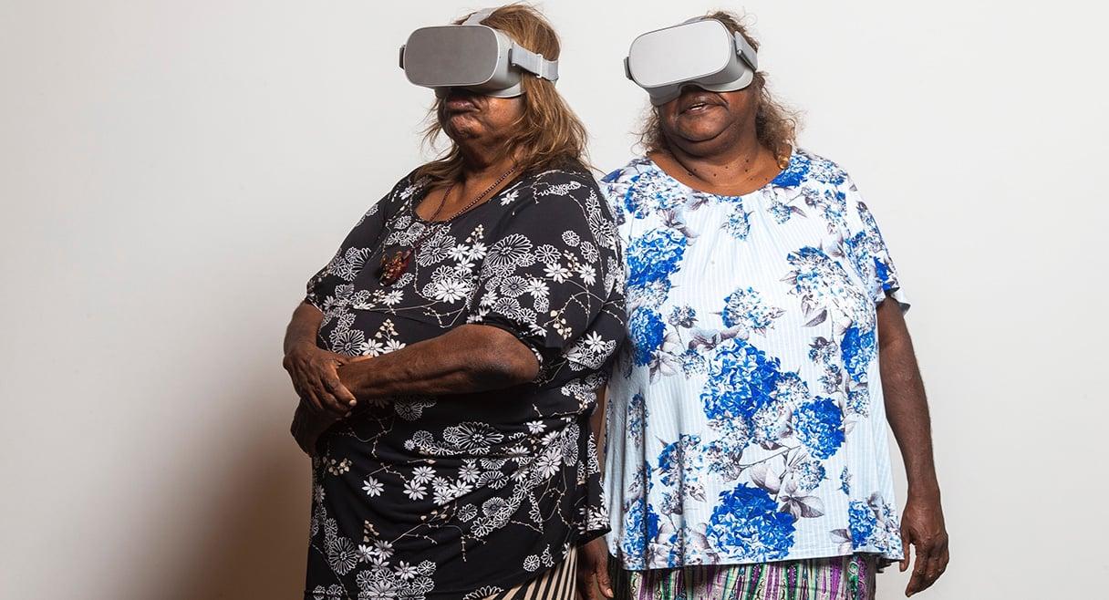 two indigenous women wearing VR headsets